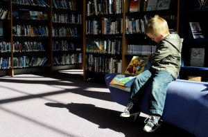 small child reading image